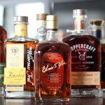 Whiskey bottles lined up